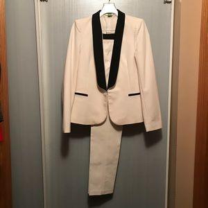 Elegant cream suit with black trim.